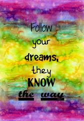follow your dreams, they know the way. Motivational quote on watercolor texture.