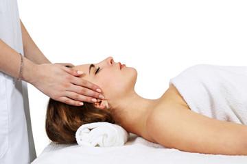 Woman receiving head massage