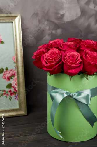 bouquet of delicate red roses in green gift box on dark grey rustic wooden background home. Black Bedroom Furniture Sets. Home Design Ideas