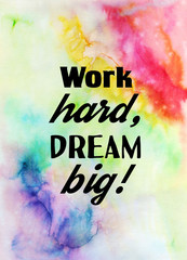 Work hard, dream big! Motivational quote on watercolor texture.