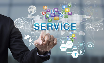 Businessman hand chooses Service wording on interface screen. internet technology service concept. can used for cover page presentation and web banner.