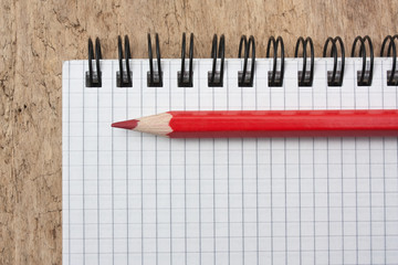 red pencils and notebook