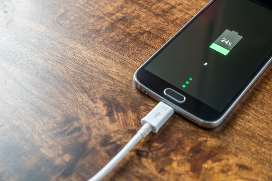 Mobile smartphone charging battery close-up