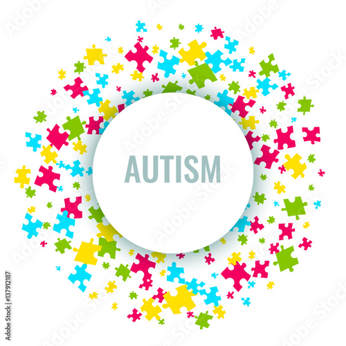 Autism Awareness Poster With Puzzle Pieces In A Circle On White