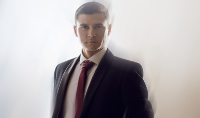 Young man in a tuxedo with tie. Business man, the effect of blurred movement