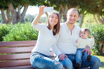 young family taking selfie with smartphone