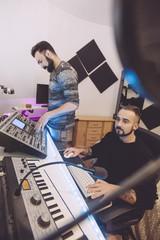 music engineers working on the studio