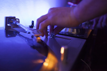 dj editing music levels on the console operator.