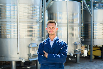 Portrait of young man winery worker.