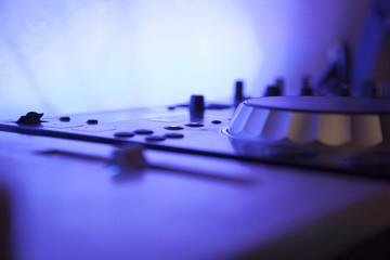 close up of a music console with blue led light
