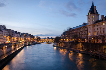 Paris scenic view on Seine and Pont Neuf at twilight