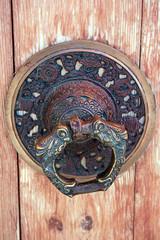 vintage solid wrought handle on  wooden door