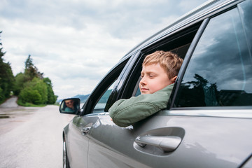 Traveling by auto - son and father look out from car windows