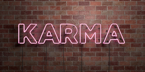 KARMA - fluorescent Neon tube Sign on brickwork - Front view - 3D rendered royalty free stock picture. Can be used for online banner ads and direct mailers..