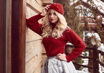 Georgeous elegant blonde in red dress and hat