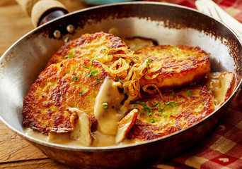 Fried Potato Pancakes with Cream Sauce and Apples