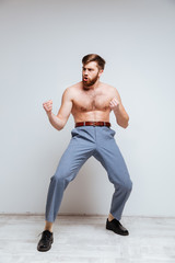 Vertical image of Male nerd as fighter