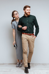 Vertical image of Berdad man with female nerd behind him