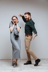 Vertical image of man screming at the female nerd