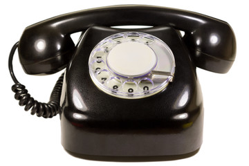 Isolated old dial telephone in black close-up on white background