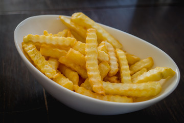 Closeup of french fries on a bowl