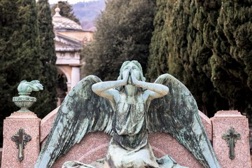 Genoa (Genova), Italy - February 19, 2017: Statue of a praying angel