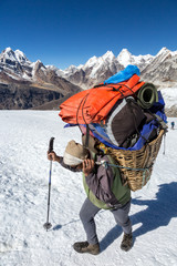 Nepalese Porter carrying Basket with Mountain Expedition Luggage