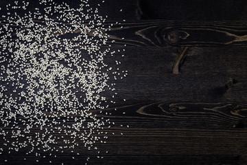 white sesame seeds in dark background