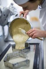Lebkuchenteig being transferred to baking tins