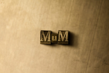 MUM - close-up of grungy vintage typeset word on metal backdrop. Royalty free stock illustration.  Can be used for online banner ads and direct mail.