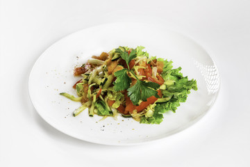 Plate of fresh vegetable salad isolated at white background.