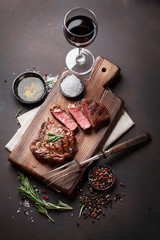 Wall Mural - Grilled ribeye beef steak with red wine, herbs and spices
