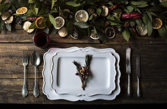 Setting table with fruit and laurel leaves