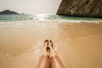 Legs on the beach. Turkey, Kas, Kaputas beach.