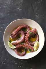 Portuguese cooked octopus with olive oil,garlic and parsley