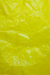 Crumpled recycle yellow paper background.