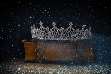 low key of diamond queen crown on old book