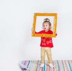 Portrait of a cute little girl with decoration picture frame