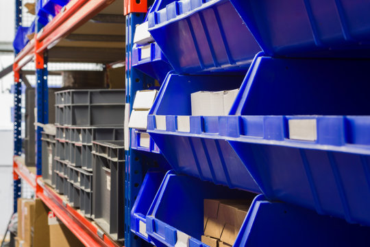 Storage bins and industrial storage racks in a warehouse shot with shallow focus
