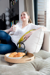 gorgeous woman sitting on comfortable sofa for happy morning time
