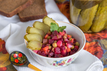 Russian salad boiled vegetables with carrots, beets, potatoes, peas, pickles and oil