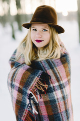girl in the hat wrapped in a blanket