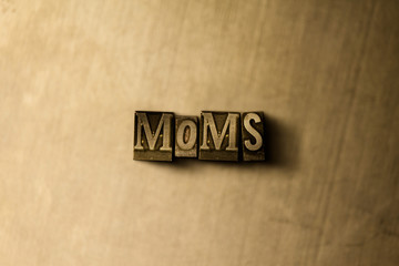 MOMS - close-up of grungy vintage typeset word on metal backdrop. Royalty free stock illustration.  Can be used for online banner ads and direct mail.