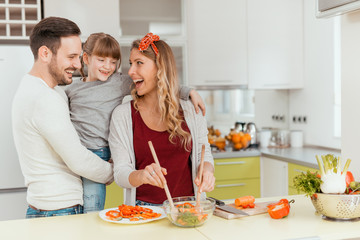 Happy young family in the kitchen