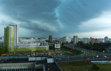 Thunderstorm in the city, the city of Minsk, Belarus, July, summer, day, construction of residential houses, overpass,