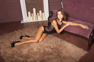 Beautiful brunette woman in black lingerie underwear in rich elegant interior in sexy fashion poses. indoor. studio