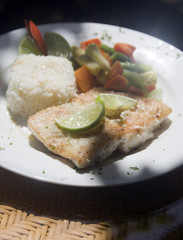 fresh fish fillet with garlic lime rice Central American vegetables as photographed in Big Corn Island Nicaragua