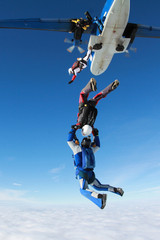 Two skydivers have just jumped out of a plane