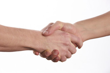 Closeup image of a Business handshake. Business handshake and business people concept. Two men shaking hands over isolated white background. Partnership, Deal.