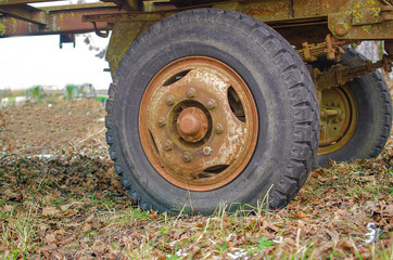 Leak wagon wheel, which is old tire, in farm